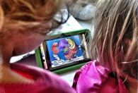 Photo of toddlers with a tablet. Photo by Wayan Vota