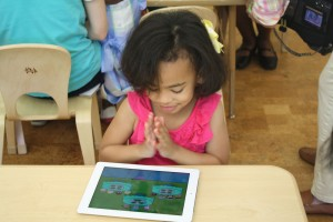 One student applauds while testing out the Next Generation Math Project's app.